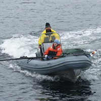 Researchers returning from photographing and tagging humpback whales